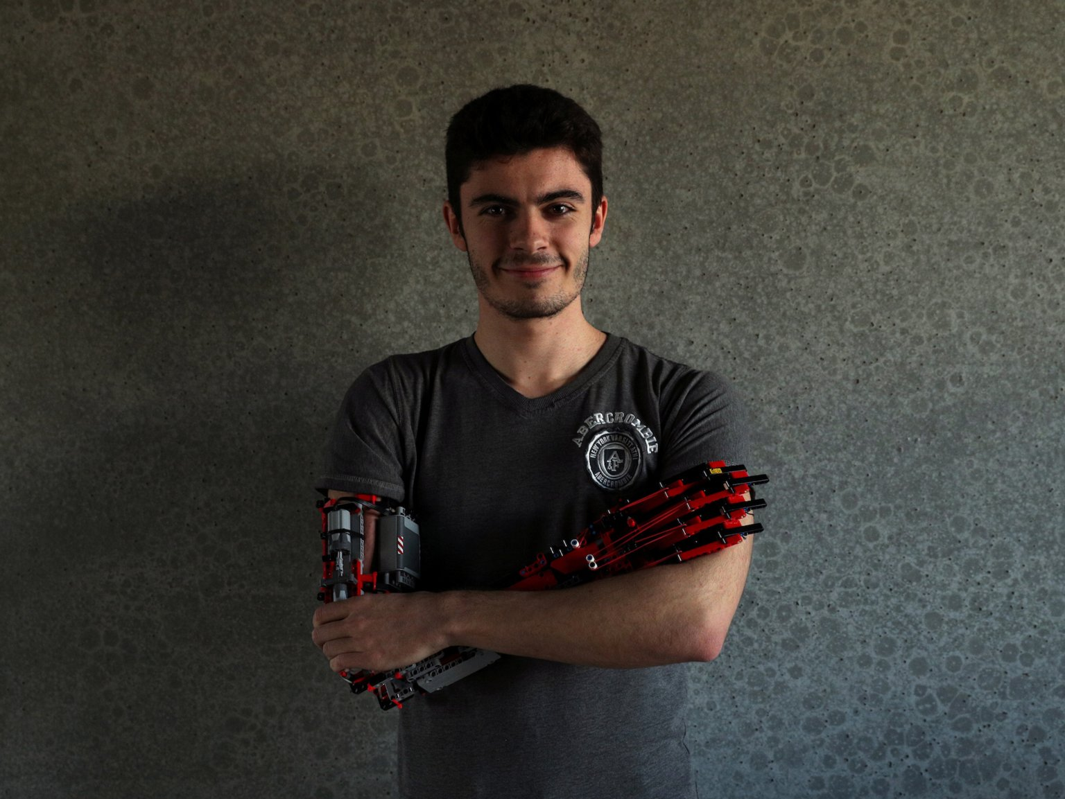 David Aguilar Poses with Lego Arm