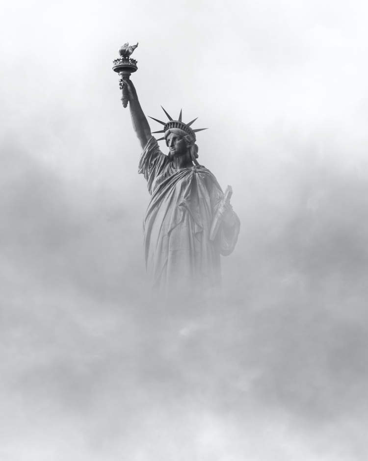 Statue of Liberty in Fog by Tom Coe on Unsplash